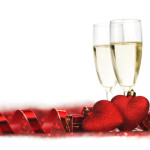 Champagne and valentines day decoration on red glitter background